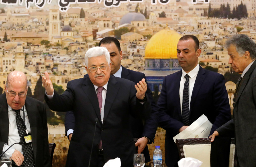 Palestinian President Mahmoud Abbas arrives to attend the meeting of the Palestinian Central Council in the West Bank city of Ramallah January 14, 2018.  (photo credit: REUTERS/MOHAMAD TOROKMAN)
