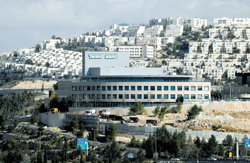 A TEVA Pharmaceutical Industries building is seen in Jerusalem last year. (Ammar Awad/Reuters) (photo credit: AMMAR AWAD / REUTERS)