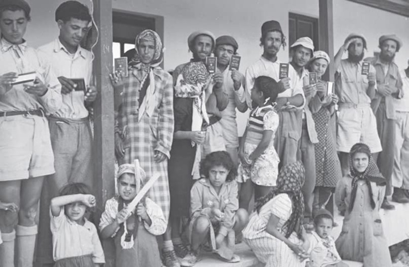 YEMENITE FAMILIES are shown in 1951 at Givat Ye'arim, a moshav just west of Jerusalem, whose initial residents arrived in Israel as part of the airlift of Jews from Yemen. (GPO) (photo credit: GPO)