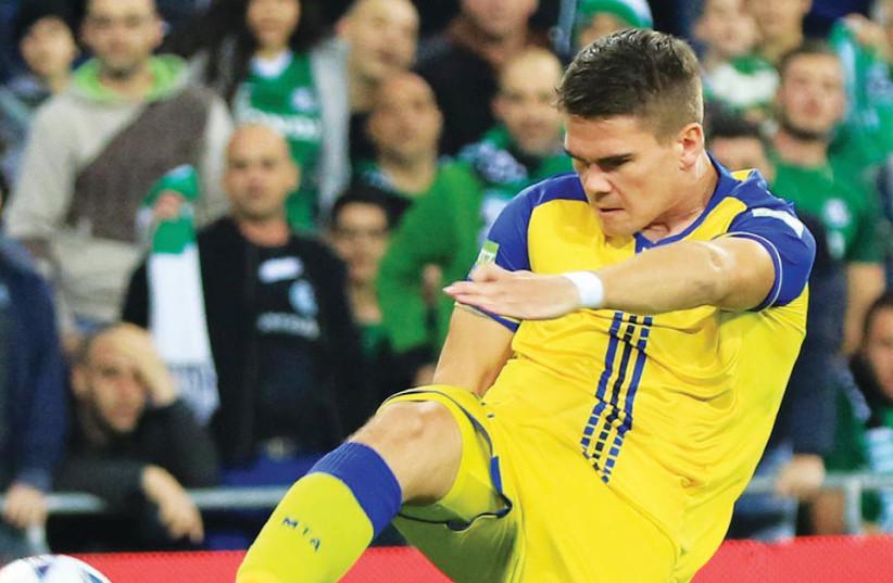 Maccabi Tel Aviv's Vidar Orn Kjartansson scores the opening goal against Maccabi Haifa (photo credit: ERAN LUF)