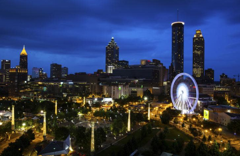 SkyView Atlanta, a 200-foot (61-meter) tall Ferris wheel with 42 gondolas, is seen on the South end of Centennial Park in downtown Atlanta, Georgia July 19, 2013. (photo credit: CHRIS ALUKA BERRY/ REUTERS)