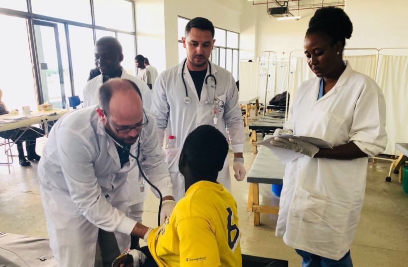 Medical professionals from Sheba Medical Center and Zambia work together to treat a child as part of their joint efforts to combat the current African Cholera outbreak (photo credit: Courtesy)