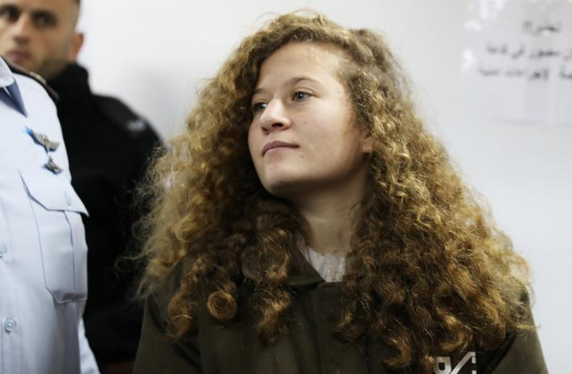 Palestinian teen Ahed Tamimi enters a military courtroom at Ofer Prison, near the West Bank city of Ramallah, January 15, 2018. REUTERS/Ammar Awad (photo credit: AMMAR AWAD/REUTERS)