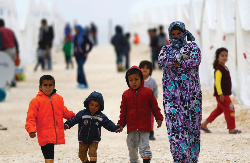DISPLACED SYRIANS walk in a refugee camp in the Turkish border town of Suruc in January 2015 (photo credit: OSMAN ORSAL/REUTERS)