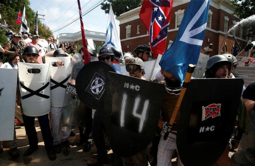 White supremacists stand behind their shields at a rally in Charlottesville, Virginia, US, August 12, 2017 (photo credit: REUTERS/JOSHUA ROBERTS)