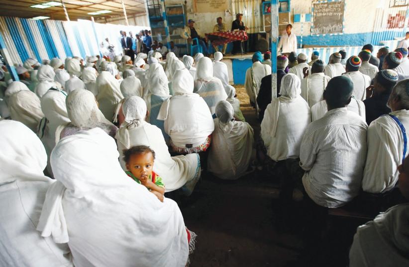 MEMBERS OF the Falash Mura Jewish Ethiopian community attend a prayer service at the HaTikvah Synagogue in Gondar, northern Ethiopia, in 2016.  (photo credit: TIKSA NEGERI / REUTERS)