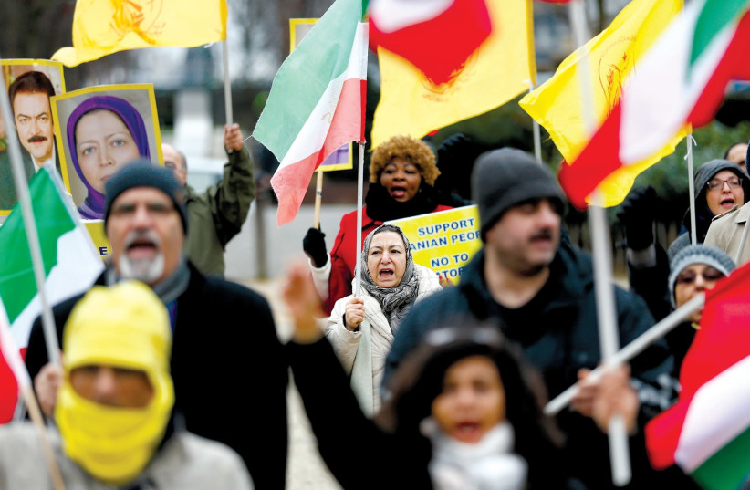 Protesters supporting the Iranian protests outside the European Union Council in Brussels, Belgium. (photo credit: REUTERS/FRANCOIS LENOIR)