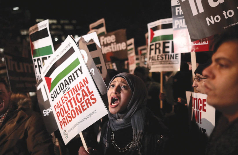 Protesters in London demonstrate in December outside the US Embassy against President Donald Trump's decision to recognize Jerusalem as Israel's capital. (photo credit: SIMON DAWSON/ REUTERS)