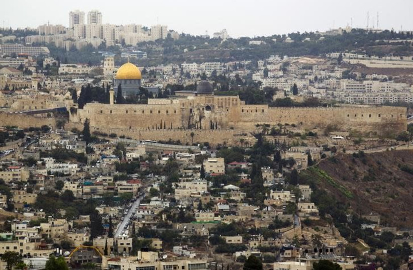 A general view of Jerusalem's old city shows the Dome of the Rock in the compound known to Muslims as Noble Sanctuary and to Jews as Temple Mount, October 25, 2015 (photo credit: REUTERS/AMIR COHEN)