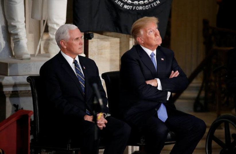 US President Donald Trump looks at the Capitol Rotunda as he sits with US Vice President Mike Pence during a Congressional Gold Medal ceremony honoring former Senate majority leader Bob Dole on Wednesday. (photo credit: REUTERS)