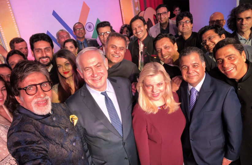 Benjamin Netanyahu and wife Sara taking a selfie with noted Indian actors during a state visit in India  (photo credit: AVI OHAYON - GPO)