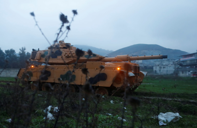 A Turkish military tank arrives at an army base in the border town of Reyhanli near the Turkish-Syrian border in Hatay province, Turkey. (photo credit: REUTERS)