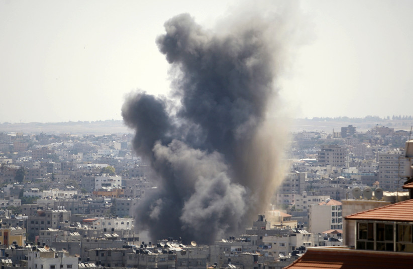 Smoke rises following what witnesses said was an Israeli air strike in Gaza August 21, 2014. (photo credit: AHMED ZAKOT / REUTERS)