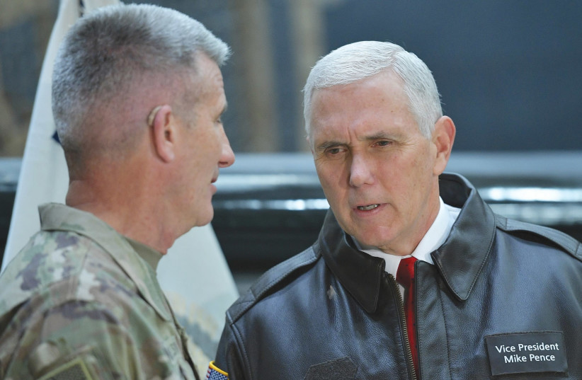 US Vice President Mike Pence (right) chats with Gen. Nick Nicholson, commander of US forces in Afghanistan, shortly after arriving at Bagram Air Field in December (photo credit: MANDEL NGAN/POOL/REUTERS)