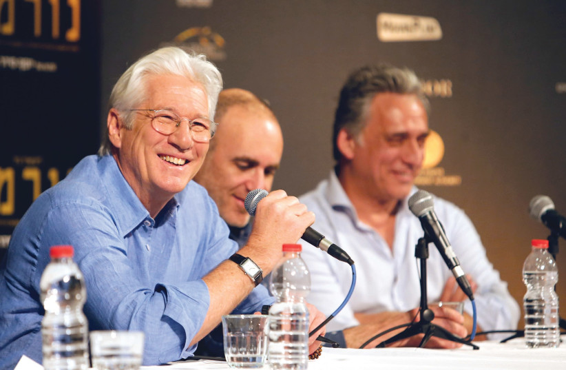 Actor Richard Gere left), director Joseph Cedar (center) and actor Lior Ashkenazi hold a news conference following the screening of the film 'Norman: The Moderate Rise And Tragic Fall Of A New York Fixer' at the Jerusalem Cinematheque in Jerusalem last March (photo credit: NIR ELIAS / REUTERS)