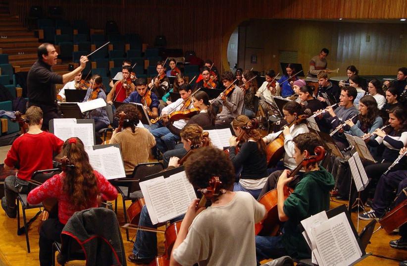 The Thelma Yellin High School of the Arts symphony orchestra with Menahem Nebenhaus conducting (photo credit: ETAN TAL/WIKIMEDIA COMMONS)