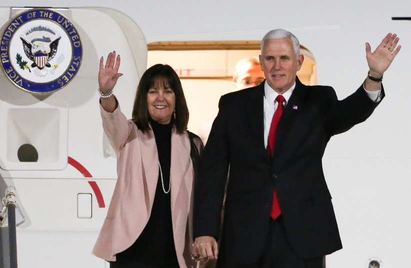US Vice President Mike Pence and his wife Karen Pence wave before leaving Air Force Two upon their arrival in the Jordanian capital Amman (photo credit: KHALIL MAZRAAWI / AFP)