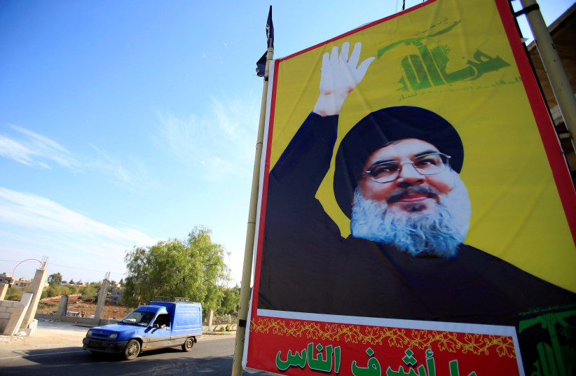 A poster of Hezbollah Secretary-General Hassan Nasrallah in southern Lebanon (photo credit: ALI HASHISHO/REUTERS)