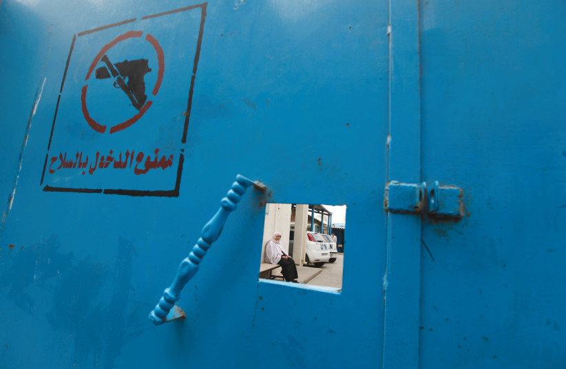 THE GATE of an UNRWA office in Gaza. (photo credit: REUTERS)