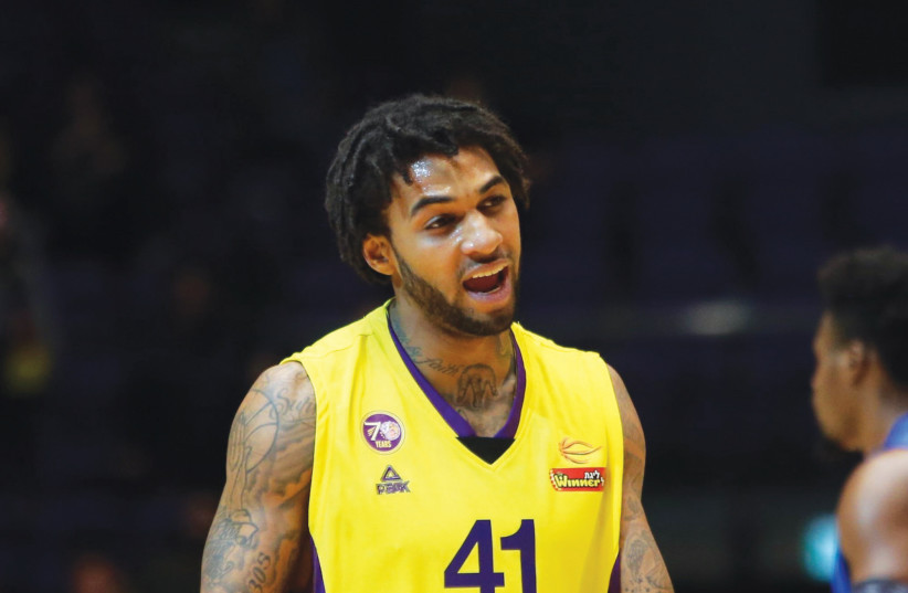 Hapoel Holon forward Glen Rice Jr. scored a team-high 18 points in last night's 91-77 win over Bnei Herzliya, while also punting the ball into the stands in a moment of madness in the second quarter. (photo credit: UDI ZITIAT)