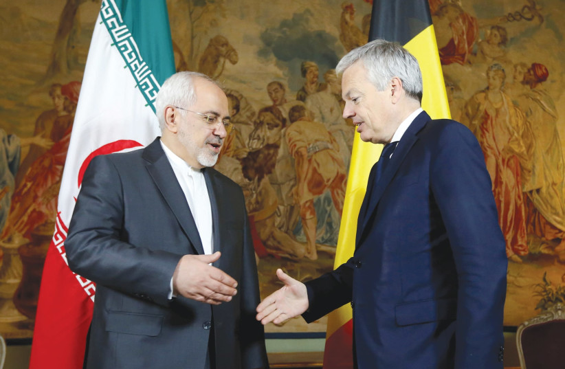 BELGIAN FOREIGN MINISTER Didier Reynders (right) welcomes his Iranian counterpart, Muhammad Javad Zarif, at Egmont Palace in Brussels in January 2018. (photo credit: REUTERS/FRANCOIS LENOIR)