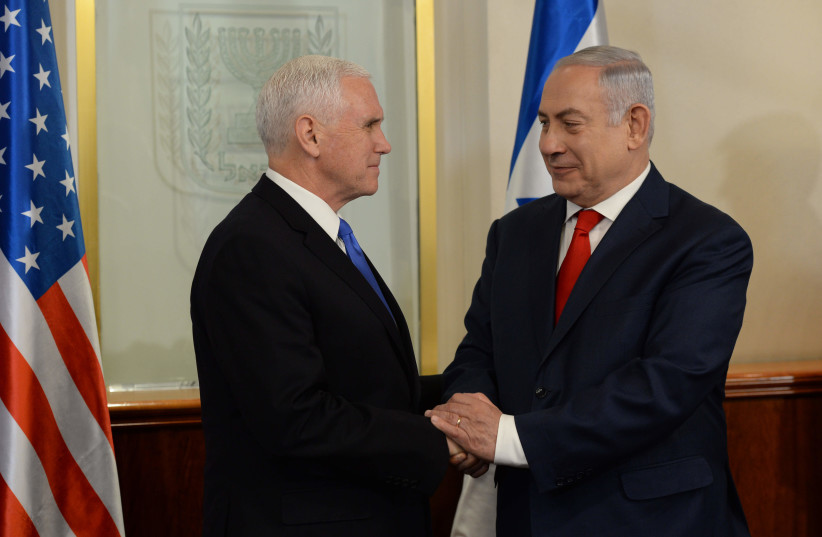 Prime Minister Benjamin Netanyahu shakes hands with Vice President of the United States Mike Pence (photo credit: CHAIM TZACH/GPO)