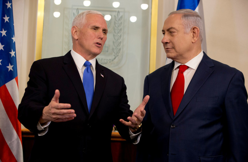 US Vice President Mike Pence speaks with Israeli Prime Minister Benjamin Netanyahu during a meeting at the Prime Minister's office in Jerusalem (photo credit: REUTERS/ARIEL SCHALIT/POOL)