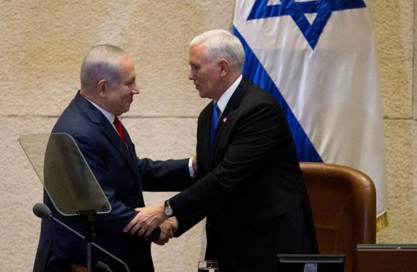 US Vice President Mike Pence shakes hands with Israeli Prime Minister Benjamin Netanyahu ahead of his address to the Knesset, Israeli Parliament, in Jerusalem January 22, 2018 (photo credit: REUTERS/ARIEL SCHALIT/POOL)