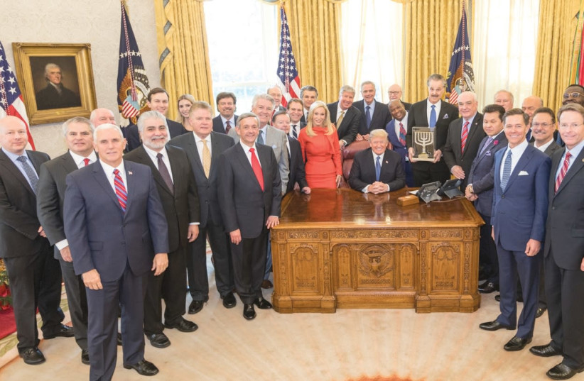 Dr. Mike Evans presents the Friends of Zion Award to US President Donald Trump at the White House last month. (photo credit: Courtesy)