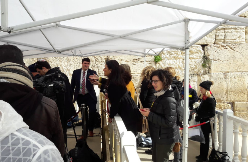 The Israeli press gathering at the Kotel moments before US Vice President Pence arrives. (photo credit: HERB KEINON)