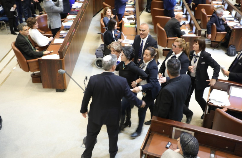 MK Haneen Zoabi [Balad] removed from Knesset after protesting during speech by US Vice President Mike Pence  (photo credit: YITZHAK HARARI)