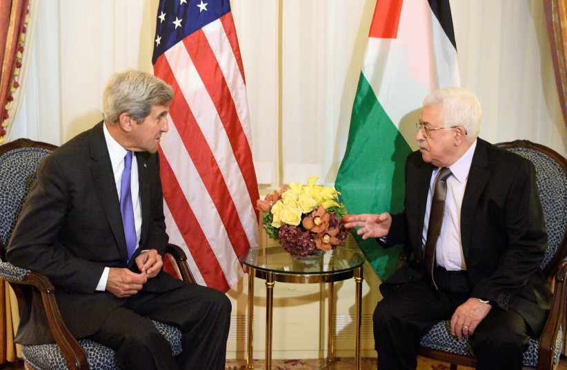 Then-U.S. Secretary of State John Kerry speaks with Palestinian Authority President Mahmoud Abbas during a bilateral meeting at the Waldorf Astoria in Manhattan on September 19, 2016.  (photo credit: REUTERS/DARREN ORNITZ)