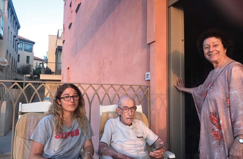 Avraham Manoach is seen with his wife Chaya and his granddaughter in Jaffa in November. (photo credit: Courtesy)