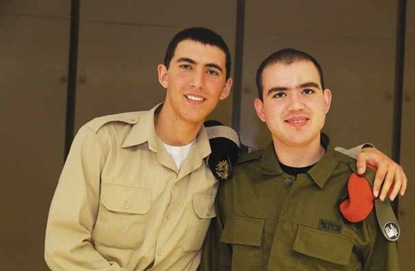 Ilay (right) poses with his brother Adam during his IDF swearing in ceremony last year.  (photo credit: Courtesy)