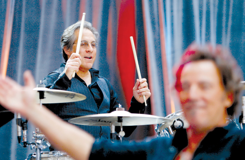 BRUCE SPRINGSTEEN performs with drummer Max Weinberg (top) of E Street Band during a concert at in New York in 2012 (photo credit: LUCAS JACKSON/REUTERS)