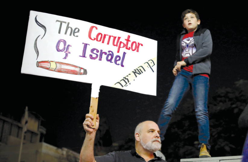 ISRAELIS TAKE PART in a protest against corruption in Tel Aviv last year (photo credit: AMIR COHEN/REUTERS)