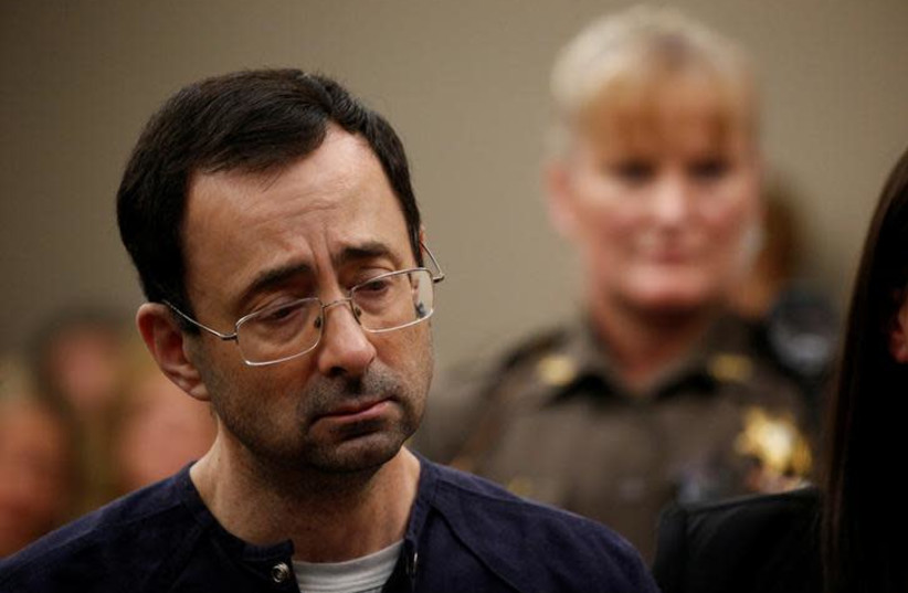 Larry Nassar, a former team USA Gymnastics doctor who pleaded guilty in November 2017 to sexual assault charges, stands during his sentencing hearing in Lansing, Michigan, US, January 24, 2018.  (photo credit: BRENDAN MCDERMID/REUTERS)