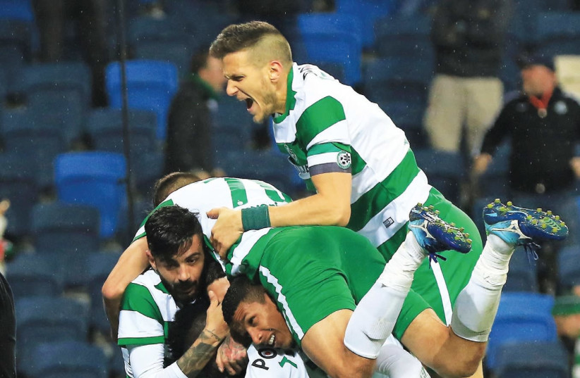 Maccabi Haifa players celebrate their second goal in last night's 3-0 win over Maccabi Tel Aviv in the State Cup round-of-16 (photo credit: ERAN LUF)