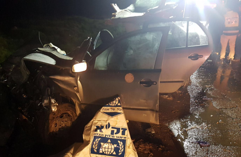 The site of a car crash on Route 557 in the West Bank on January 24, 2018. (photo credit: NATI SHAPIRA)