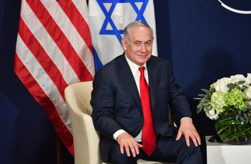 Israel's Prime Minister Benjamin Netanyahu during a meeting with US President Trump at the World Economic Forum in Davos, Switzerland (photo credit: NICHOLAS KAMM / AFP)