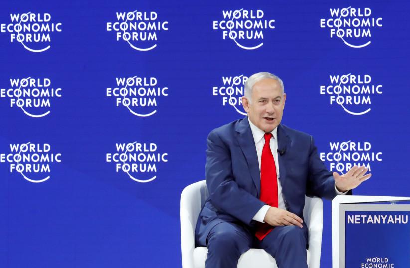 srael's Prime Minister Benjamin Netanyahu gestures as he speaks the World Economic Forum (WEF) annual meeting in Davos, Switzerland January 25, 2018 (photo credit: DENIS BALIBOUSE / REUTERS)