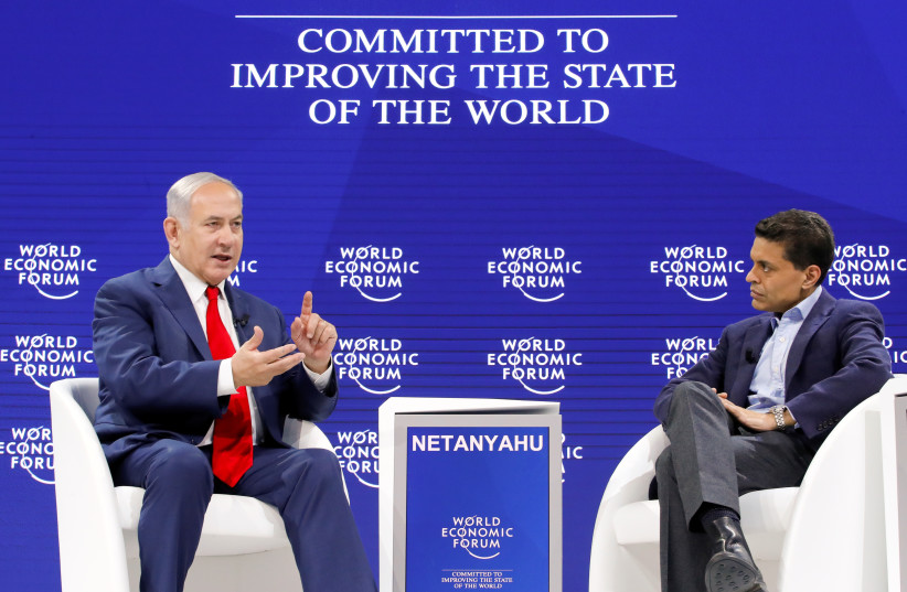 Israel's Prime Minister Benjamin Netanyahu speaks to the host Fareed Zakaria during the World Economic Forum (WEF) annual meeting in Davos, Switzerland January 25, 2018. (photo credit: REUTERS)