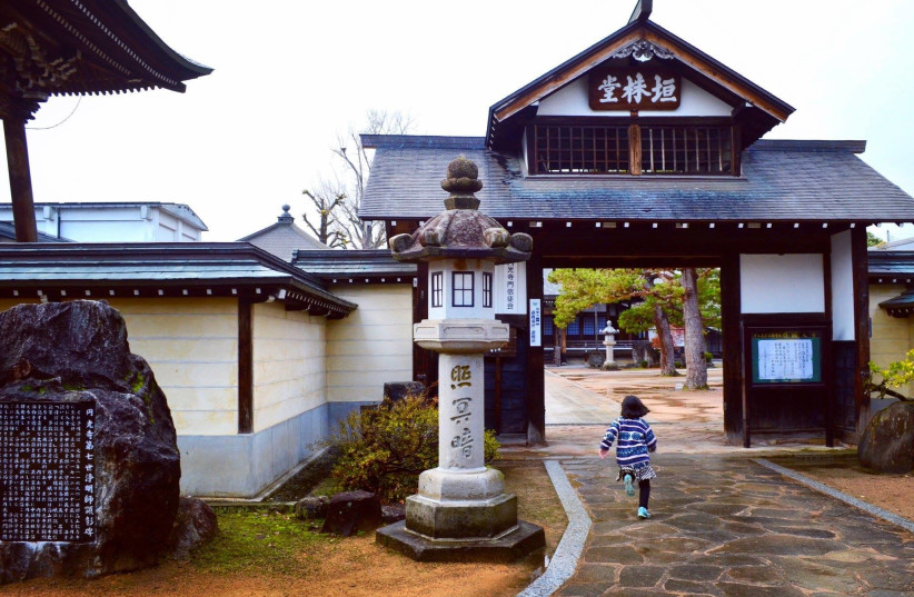 A girl runs toward a shrine in Hida Furukawa, in Japan's Gifu prefecture, where the local government is promoting Chiune Sugihara's legacy as a tourism draw. (Michael Wilner, November 2017) (photo credit: MICHAEL WILNER)