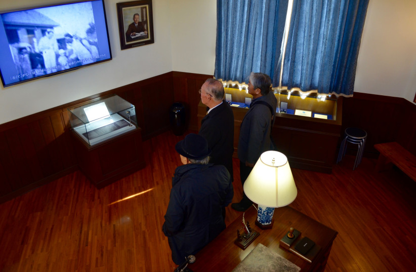 In Chiune Sugihara Memorial Hall in Yaotsu, Japan, locals watch a video documenting his actions in a replica of the diplomat's Kaunas office. (Michael Wilner, November 2017) (photo credit: MICHAEL WILNER)