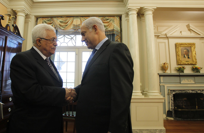 Israel's Prime Minister Benjamin Netanyahu (R) greets Palestinian President Mahmoud Abbas in the Monroe Room of the State Department in Washington September 2, 2010. (photo credit: REUTERS/JASON REED)