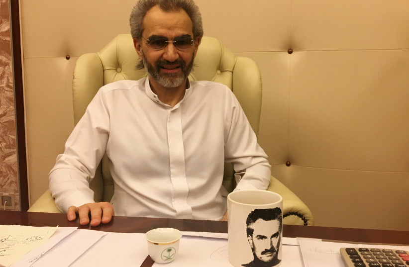 Saudi Arabian billionaire Prince Alwaleed bin Talal sits for an interview with Reuters in the office of the suite where he has been detained at the Ritz-Carlton in Riyadh, Saudi Arabia January 27, 2018 (photo credit: REUTERS)