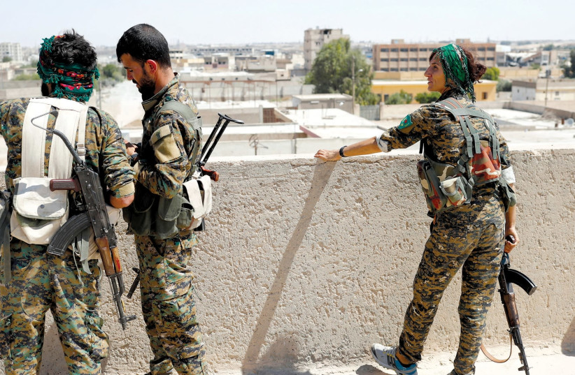 Members of the People's Protection Units in Raqqa last year. (photo credit: REUTERS)