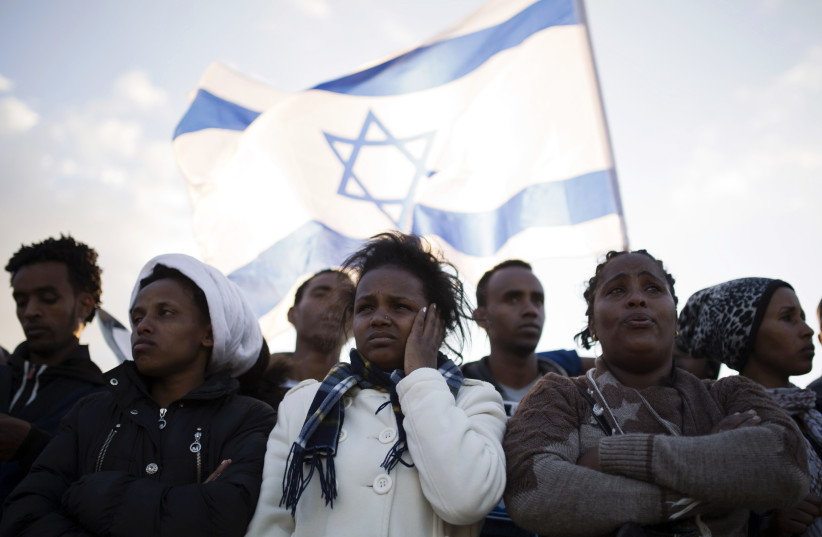 African migrants take part in a protest against Israel's detention policy toward them (photo credit: AMIR COHEN/REUTERS)
