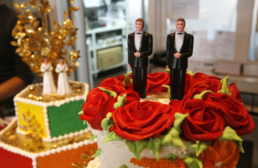 Bride and groom figurines are on display on wedding cakes at Cake and Art bakery in West Hollywood, California. (photo credit: REUTERS)