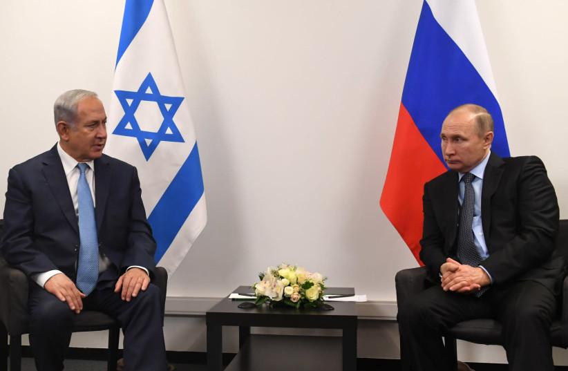 Prime Minister Benjamin Netanyahu and Russian President Vladimir Putin meet in Moscow on January 29, 2018. (photo credit: KOBI GIDEON/GPO)